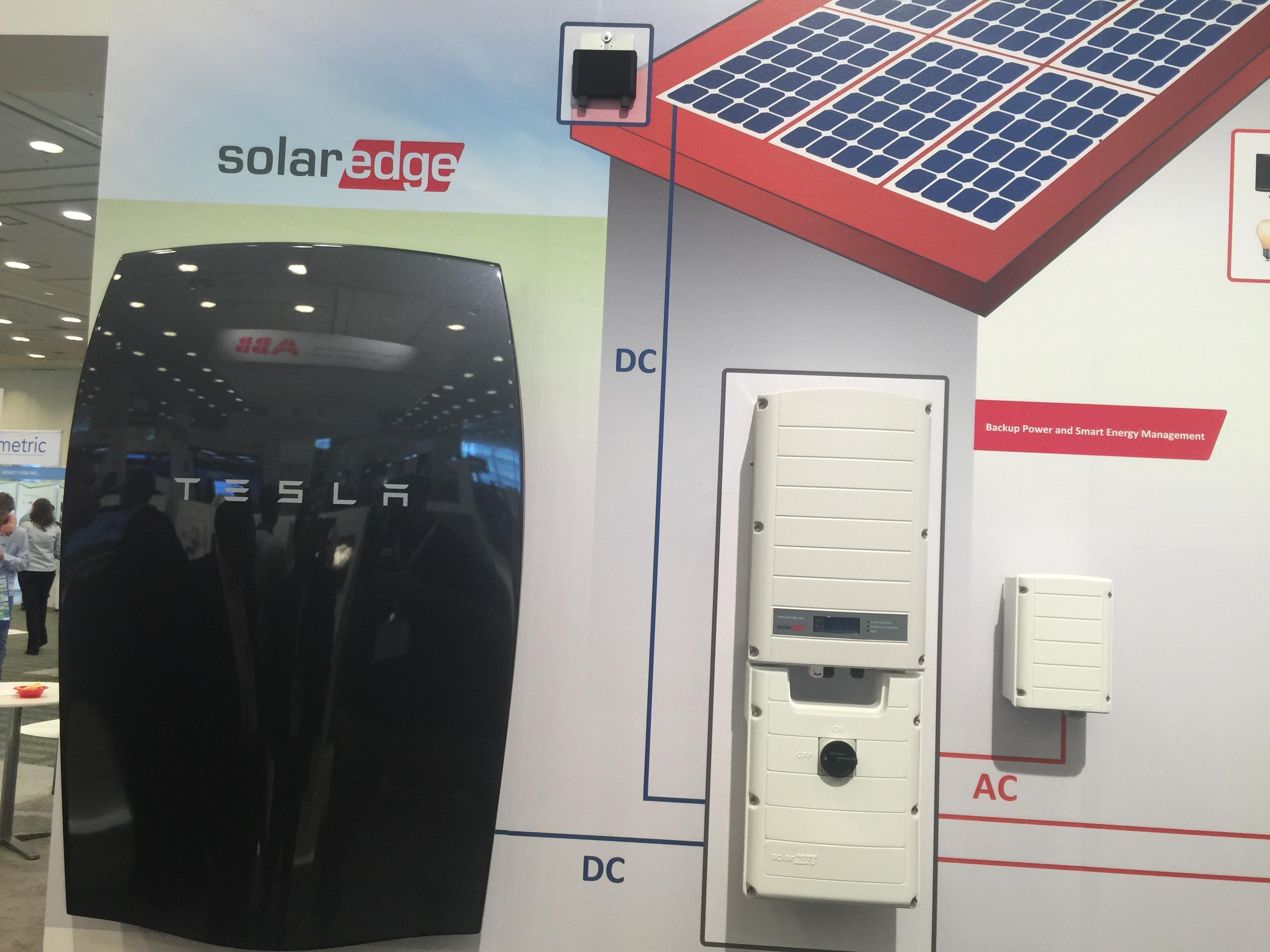 Tesla_Powerwall_and_Solar_Panels.jpg